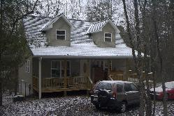 Snow's fallen on Christmas morning in Blairsville, a couple of days before I leave on the tour.  This is the house my (ex) wife chose to live in.  Sean Puckett, 2003